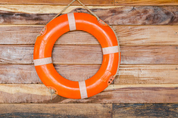 orange life buoy, on wood