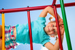 canvas print picture - Happy child on a jungle gym