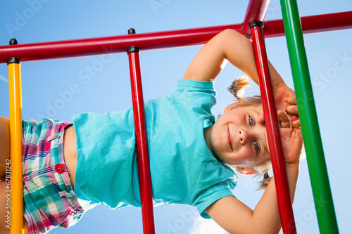 canvas print picture Happy child on a jungle gym