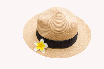 straw hat with plumeria flower on white background