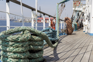 Thick ropes on a wooden sailing ship floor