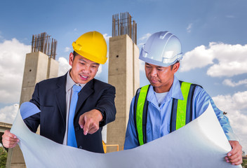 Asian engineer and worker leader discus for drawing detail