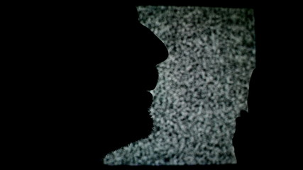 Man shouting on TV. Silhouette of unshaven male in front of stat