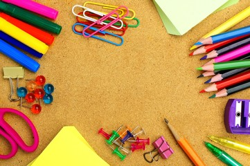 Colorful school supplies frame on a bulletin board
