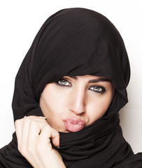 Transgressive girl wearing a burqa