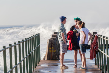 Boy Girl Family Railing Pool Beach Waves