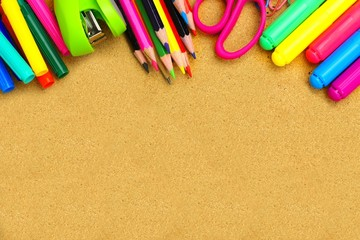 Colorful school supplies border on a bulletin board
