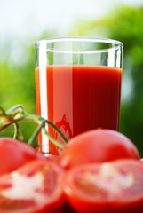 Tomatoes and juice in the garden. Organic food