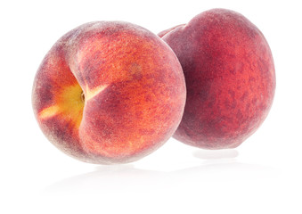 Two Fresh peaches isolated on white background