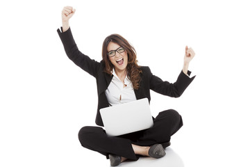 Excited woman with arms up winning online