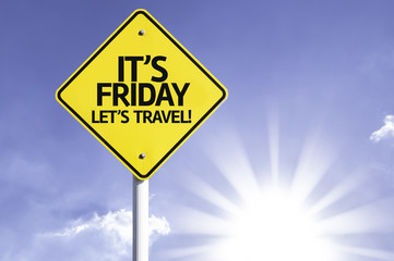 It's Friday, Lets Travel! road sign with sun background