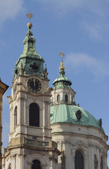 Belltower and temple dome. St. Mikulash's cathedral, Prague