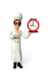 Young chef with table clock