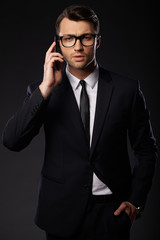 Portrait of young business man. Black background