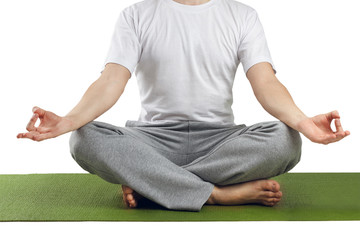 Young man in lotus pose