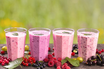 Various fresh berries smoothies