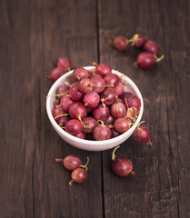 Gooseberry on wooden background