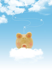Piggy bank with blue sky and clouds and airplanes