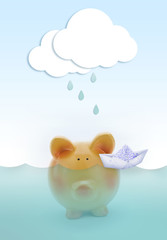 Piggy bank drowning in water, with cloud raining above