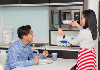 kitchen room with asian family