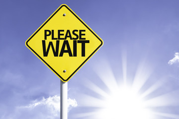 Please Wait road sign with sun background
