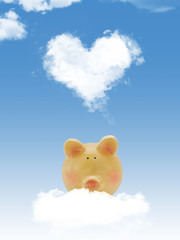 Piggy bank on cloud with heart shape cloud and blue sky
