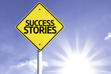 Success Stories road sign with sun background