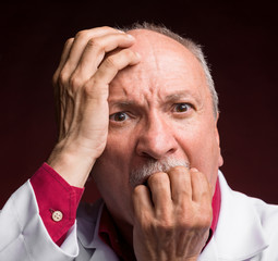 Shocked mature doctor