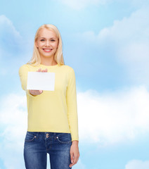 smiling girl with blank business or name card