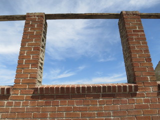 A window frame on an old brick building