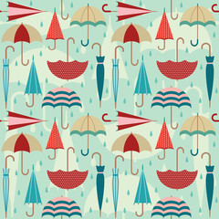 Colorful vector seamless pattern with umbrellas and raindrops