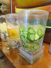 Fruit and vegetable infused ice water in a lobby.