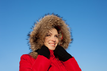 Closeup portrait of pretty young female wearing winter clothing