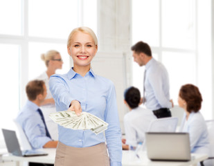 young businesswoman with dollar cash money