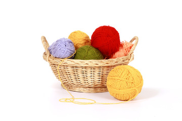 wool yarn balls in basket isolated on white