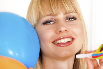 Celebrating girl with balloons and party amenities
