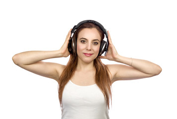 Young Pretty Woman Wearing Headphones and Listening to Music