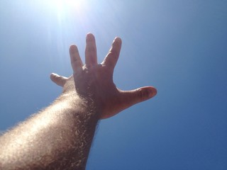 hand towards the sun