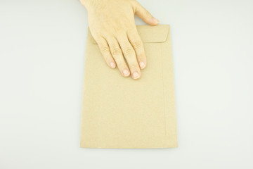 Man sending brown letter isolated