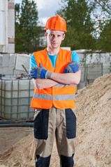 Builder standing with arms crossed