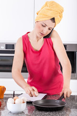Busy woman making scrambled eggs