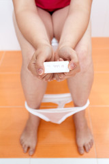Pregnant woman with a pregnancy test