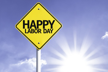 Happy Labour Day road sign with sun background
