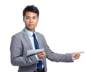 Businessman with digital tablet and finger point aside