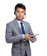 Businessman with headset and digital tablet