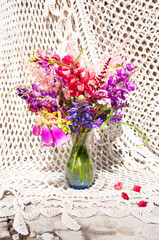still life bouquet with lupine and bright flowers