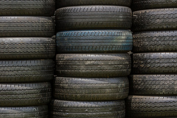 Stack of old wheel black tyres.