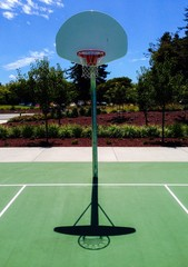basketball court with symmetrical shadow of backboard