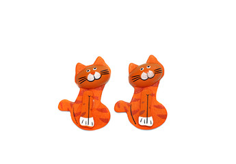Two wooden cat figure brightly painted in orange