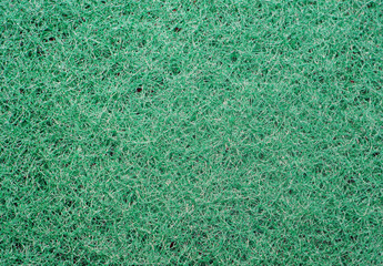 Texture of green synthetic sponge fibers